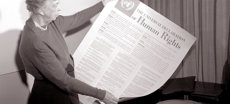UN Photo. Eleanor Roosevelt holds an English version poster of the Universal Declaration Human Rights (November 1949).